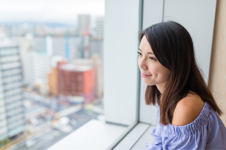 Woman looking out of office window
