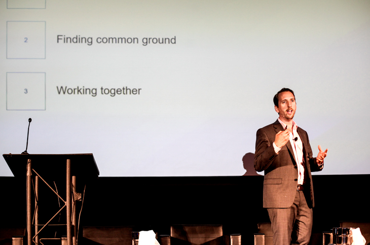 A man giving a presentation at a conference