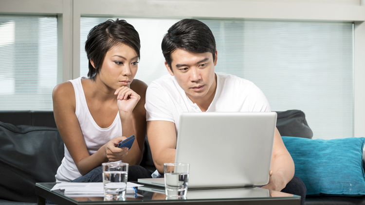 Man and woman looking at a laptop