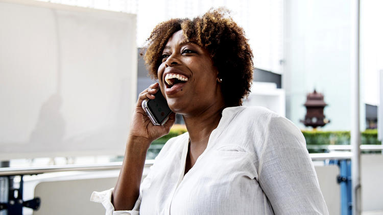 Woman speaking on the phone while smiling