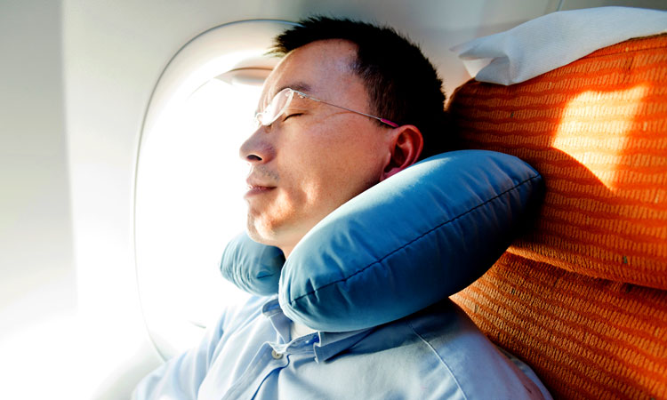 Man relaxing in an airplane seat