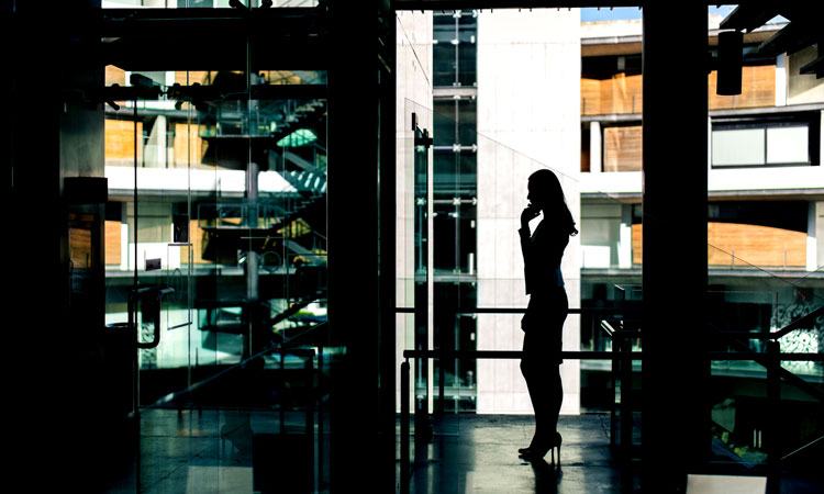 Silhouette of person speaking on phone
