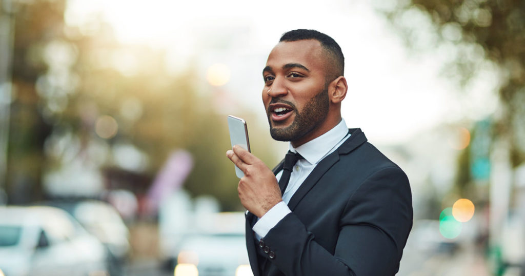 Man giving voice command to phone